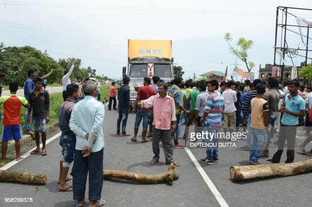 Indian supporters of Bharatiya Janata Party chant slogans as they block the National Highway 31 during a protest allegations over the ruling party of...