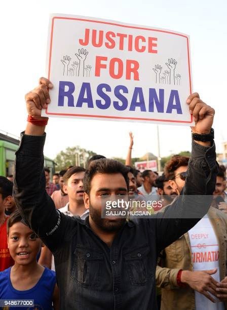 Indian supporters of Bharatiya Janata Party leader Chaudhary Lal Singh who resigned from the state cabinet over the Kathua rape and murder case of an...