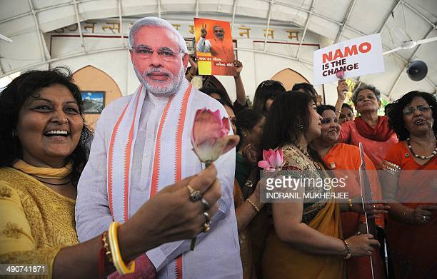 Indian supporters of chief minister of western Gujarat state and main opposition Bharatiya Janata Party prime ministerial candidate Narendra Modi...