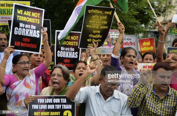 Indian supporters of Gorkhaland Movement chant slogans during the 38th day of an indefinite strike at Milanmore village in Darjeeling district on the...