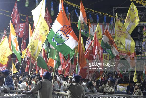 Indian supporters of grand alliance political parties waves at a rally for the campaign of the 2018 Telangana state Assembly elections in Hyderabad...