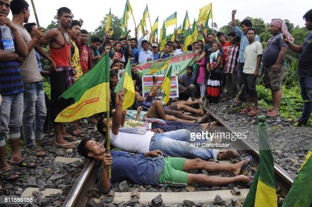 Indian supporters of Indigeneous Peoples Front of Twipra shout slogans during a national highway and railway track blockade to demand a separate...