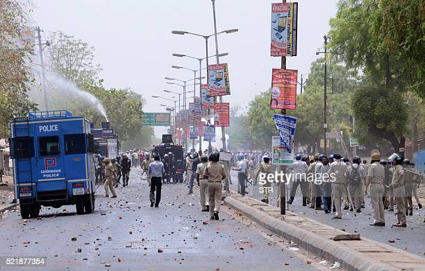 Indian supporters of Patel Patidar clash with Gujarat Police at Mehsana some 70 kms from Ahmedabad on April 17 2016 Stonethrowing protesters clashed...