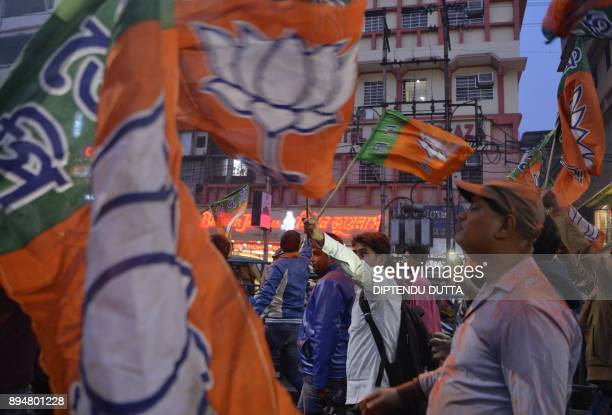 Indian supporters of ruling Bharatiya Janata Party celebrate the victory in the key states of Gujarat and Himachal Pradesh outside the party office...