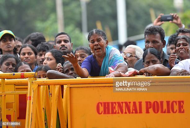 Indian supporters of Tamil Nadu Chief Minister Jayalalithaa Jayaram pay tribute at the memorial where she was laid to rest in Chennai on December 7...