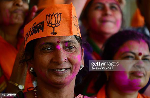 Indian supporters of the Bharatiya Janata Party celebrate the victory of their candidate at the BJP party office in Varanasi on May 16 2014The...