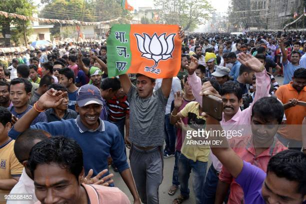 Indian supporters of the Bharatiya Janata Party celebrates at a rally as voting was underway for the Tripura legislative assembly election in...