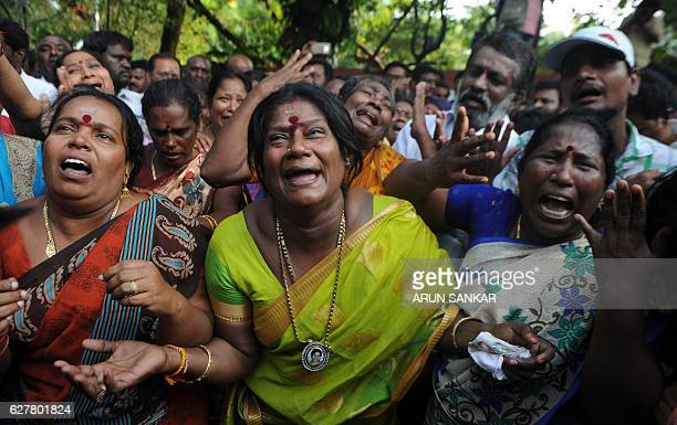 Indian supporters of the Chief Minister of Tamil Nadu Jayalalithaa Jayaram react outside the hospital where she is being treated after false reports...