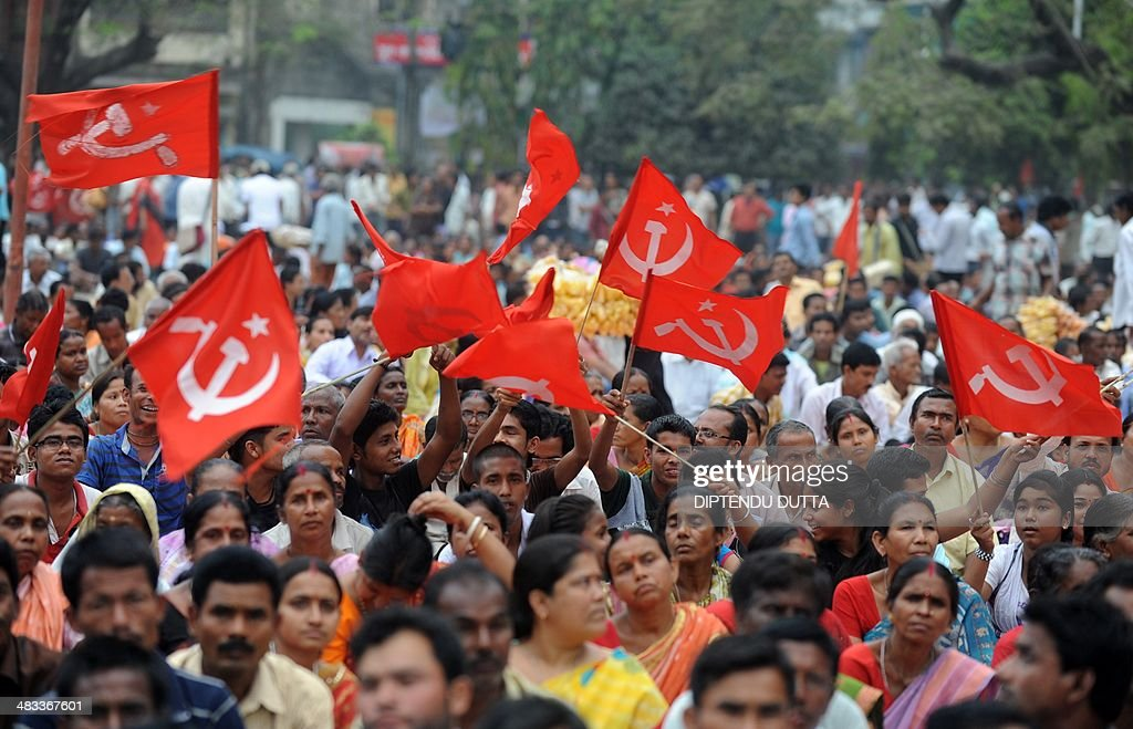 Indian supporters of the Communist Party of India Marxist (CPIM) wave party flags in support of the CPIM candidate for the Darjeeling seat Saman Pathak during an election campaign rally in Siliguri on April 8, 2014. Indians have begun voting in the world's biggest election which is set to sweep the Hindu nationalist opposition to power at a time of low growth, anger about corruption and warnings about religious unrest. India's 814-million-strong electorate are forecast to inflict a heavy defeat on the ruling Congress party, in power for 10 years and led by India's famous Gandhi dynasty. AFP PHOTO/Diptendu DUTTA