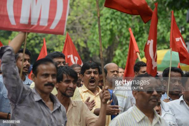 Indian supporters of the Communist Party of India shout slogans as they protest against violence allegedly by activists of the ruling Trinamool...