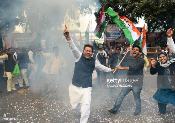 Indian supporters of the Congress Party shout slogans after the party named Rahul Gandhi president outside Congress headquarters in New Delhi on...