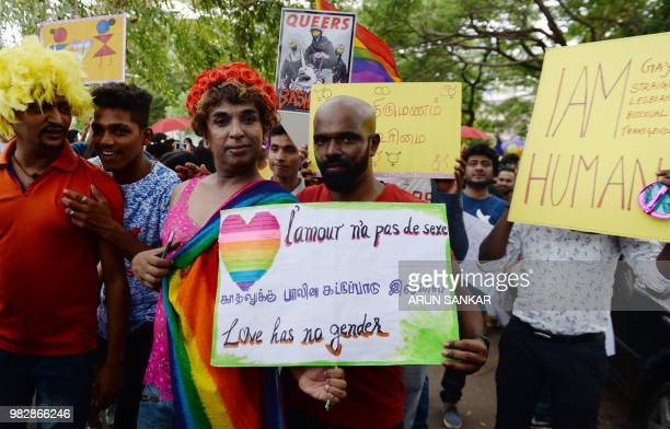 Indian supporters of the lesbian gay bisexual transgender community hold placards as they participate in a pride parade in Chennai on June 24 2018