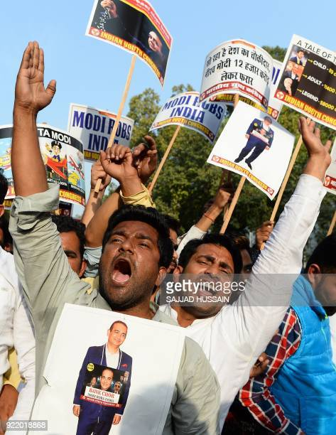 Indian supporters of the opposition Congress Party shout slogans during a protest against billionaire jeweller Nirav Modi and India's Finance...