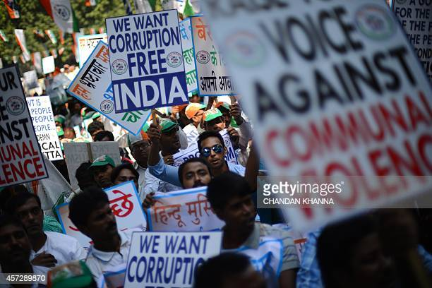 Indian supporters of the regional political party the Trinamool Congress hold placards during a protest against the ruling Indian government in New...