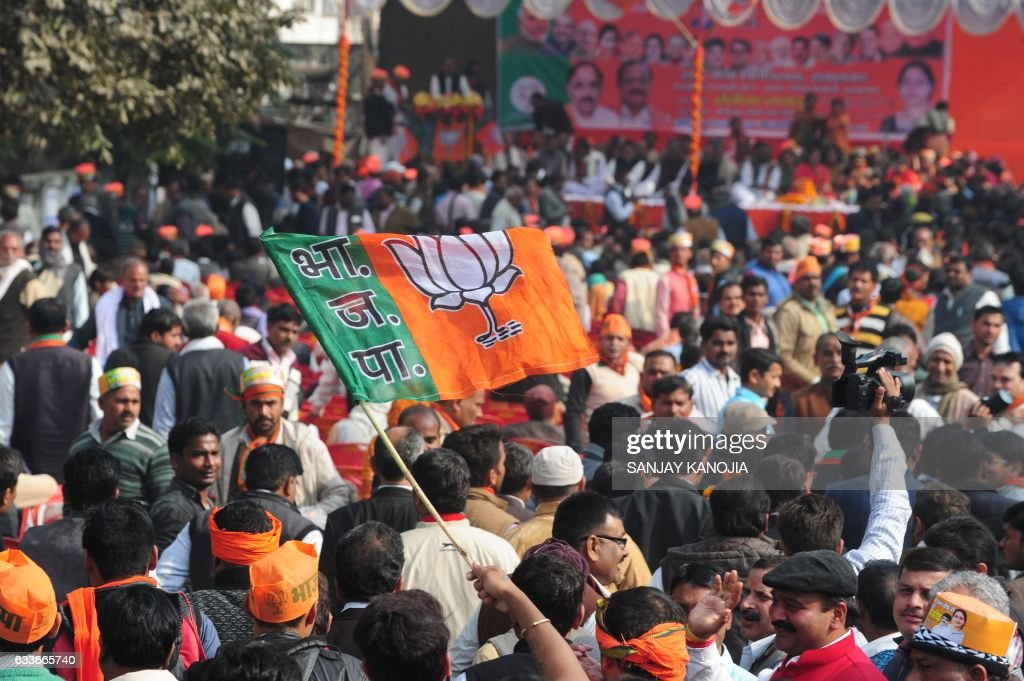 Indian supporters of the ruling Bharatiya Janata Party gather outside a district collectorate office during the nomination of party candidates ahead..
