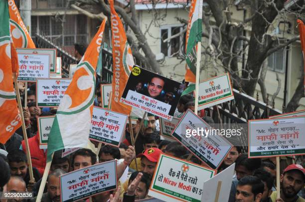 Indian supporters of the Youth Congress shout slogans and hold a placard with the picture of billionaire jeweller Nirav Modi during a protest against...
