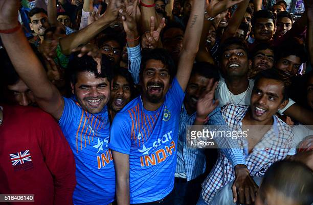 Indian supporters react during semifinal cricket match between India and West Indies of World Cup T20 tournament in Allahabad on March 312016