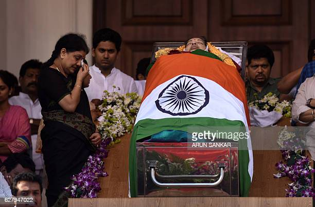 Indian supporters surround the coffin of Tamil Nadu Chief Minister Jayalalithaa Jayaram at Rajaji hall in Chennai on December 6 2016 Griefstricken...