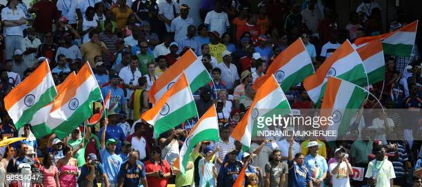 Indian supporters wave the national flag during the ICC World Twenty20 Super 8 match between Indian and West Indies at the Kensington Oval on May 9...