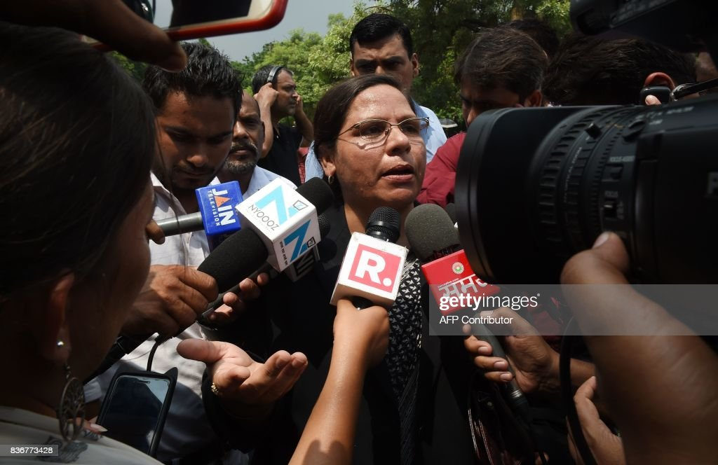 Indian Supreme Court advocate Farha Faiz (C) speaks to the media outside the Supreme Court in New Delhi on August 22, 2017. India's top court on August 22 banned a controversial Islamic practice that allows men to divorce their wives instantly, ending a long tradition that many Muslim women had fiercely opposed. PHOTO / Money SHARMA