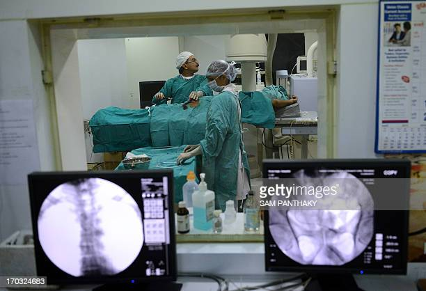 Indian surgeon Manish Raval infuses stem cells to patient Sampath Kumar who suffers from chronic kidney failure at The Institute of Kidney Disease...