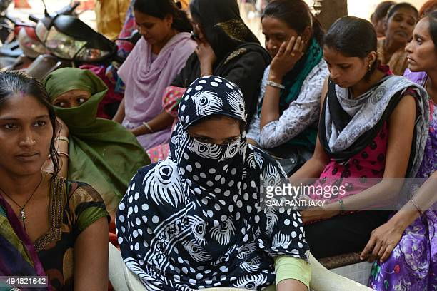 Indian Surrogate Mothers gather during a peaceful protest in the campus of Dr Nayana Patel's Kaival Hospital in Anand some 90 kms from Ahmedabad on...