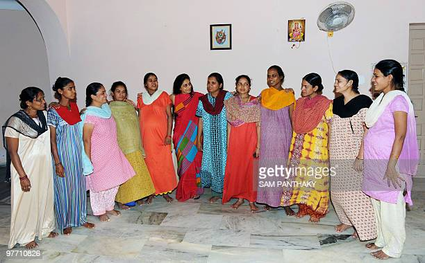 Indian surrogate mothers pose with Dr Nayna Patel at a 'surrogate mothers' home in Anand some 90 kms from Ahmedabad on March 11 2010 Commercial...