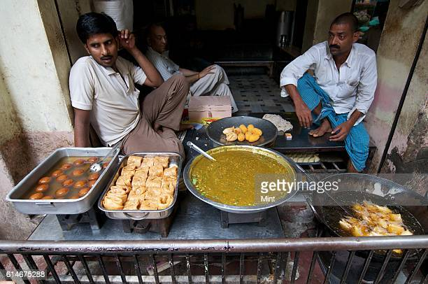 Indian sweets Long latta Gulab Jamun and Samosa with Sabzi on sale on July 20 2013 in Varanasi India Varanasi also known as Benaras is one of the...