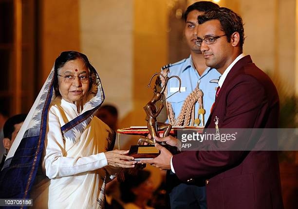 Indian swimmer Rehan Jehangir Poncha receives The Arjuna Award 2010 from Indian President Pratiba Patil during a function at The Presidential Palace...
