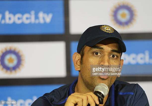 Indian T20 cricket captain Mahendra Singh Dhoni talks during a press conference ahead of the forthcoming Asia Cup tournament in Kolkata on February...