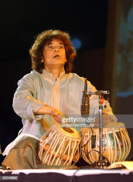Indian tabla maestro Ustad Zakir Hussain during his performance at the Mumbai Festival at Gateway of India in Bombay 22 January 2005 Zakir member of...