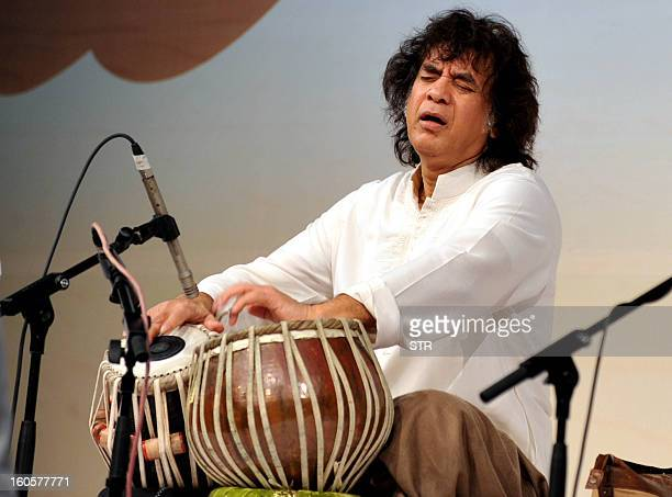 Indian tabla maestro Zakir Hussain performs on the eve of 'Homage to Abbaji ' 13th Barsi of late tabla maestro Ustad Allarakha in Mumbai on February...