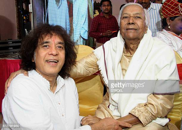 Indian tabla player and musical producer Zakir Hussain and classical music Ustad Ghulam Mustafa Khan pose for a photograph during the 16th 'Uttam...