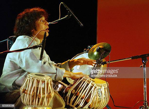 Indian tabla player Ustad Zakir Hussain performs at the Mumbai Festival in front of The Gateway of India in Bombay late 22 January 2005 Zakir is a...