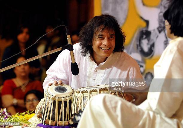 Indian tabla player Ustad Zakir Hussain performs with Mandolin player U Srinivas for the 14th Vasantotsav in Mumbai on February 27 2014 AFP PHOTO/STR