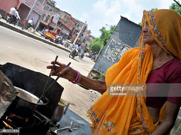 indian tea vendor - chai stock photos and pictures