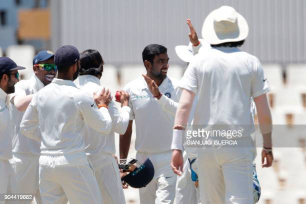 Indian team and bowler Ravichandran Ashwin celebrate the dismissal of South African batsman Dean Elgar during the first day of the second Test...