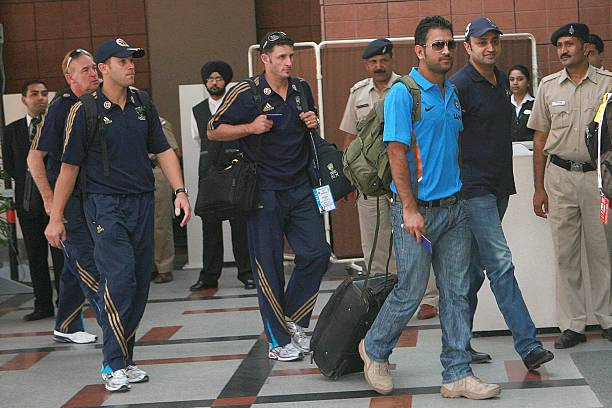 Indian team captain Mahendra Singh Dhoni arrives at the team hotel followed by the Australian players in Mohali on November 1 2009