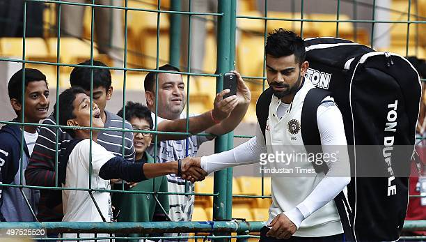 Indian team captain Virat Kohli giving autograph to the children during the 2nd Test match between India and South Africa at M Chinnaswamy Stadium on...