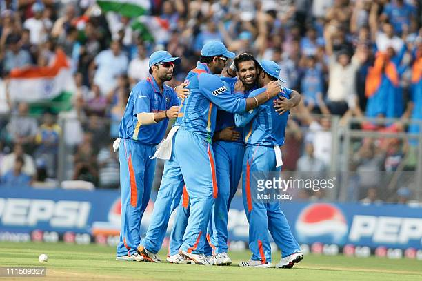 Indian team celebrate the wicket of a Sri Lankan player during the ICC Cricket World Cup 2011 Final match at The Wankhede Stadium in Mumbai on April...