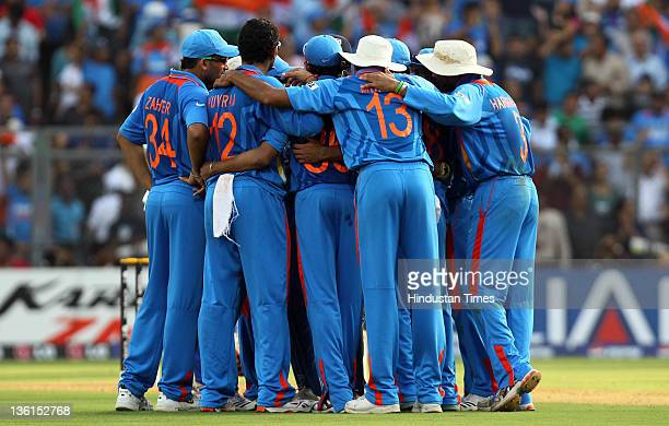 Indian team hurddle up after taking the wicket of Sri Lankan batsman Thilan Samarweera during the 2011 ICC World Cup final match between India and...