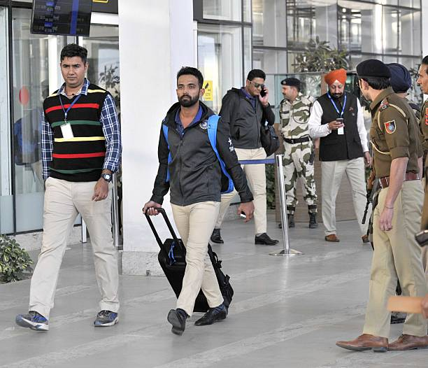 Indian team player Ajinkya Rahane along with other players come outside from the Mohali International Airport on November 22 2016 near Chandigarh...