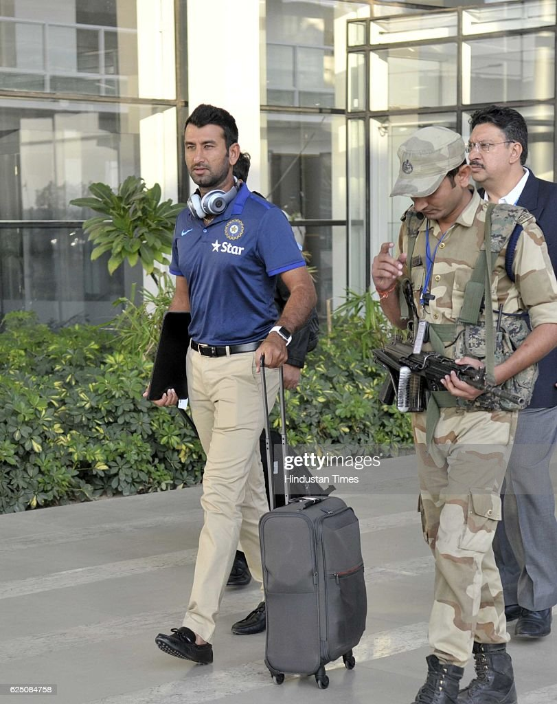 Indian team player Cheteshwar Pujara along with other players come outside from the Mohali International Airport on November 22 2016 near Chandigarh..