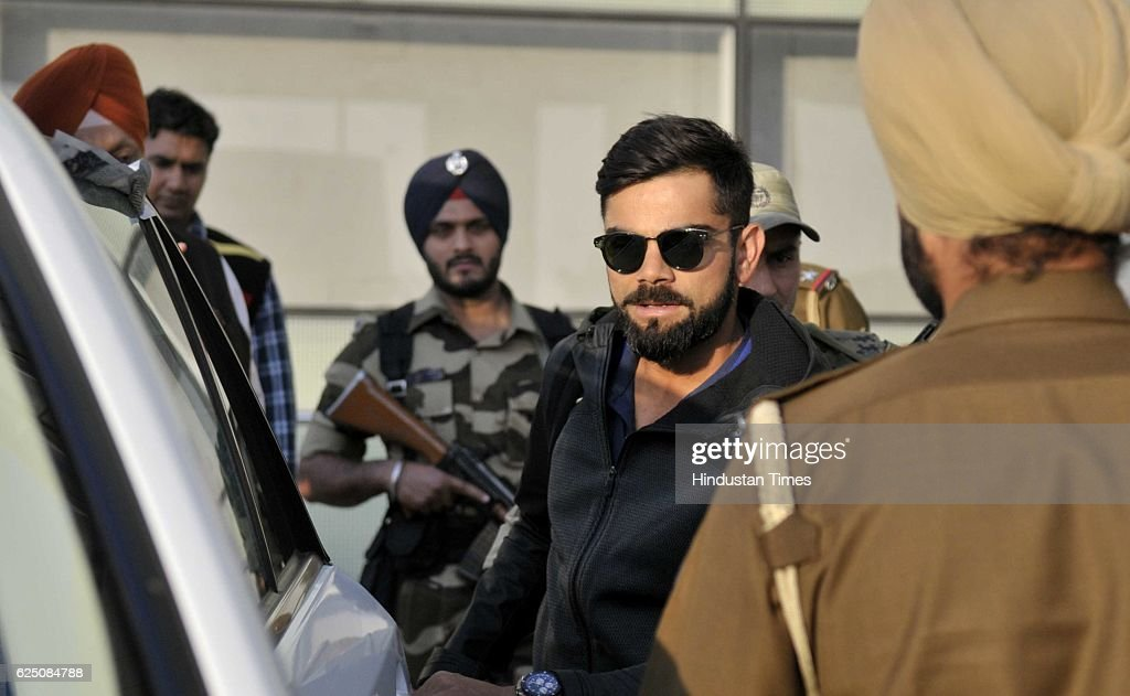 Indian team player Virat Kohli along with other players come outside from the Mohali International Airport on November 22 2016 near Chandigarh India