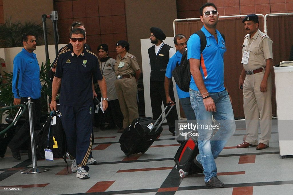 Indian team player Yuvraj Singh arrives at the team hotel followed by the Australian players in Mohali on November 1 2009