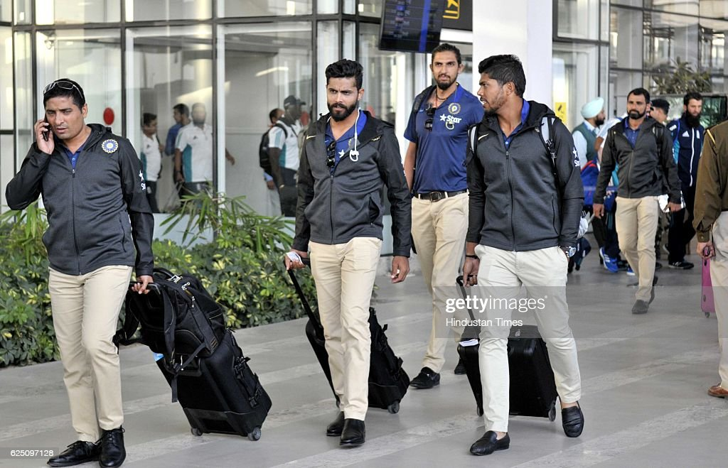 Indian team players come outside from the Mohali International Airport on November 22 2016 near Chandigarh India