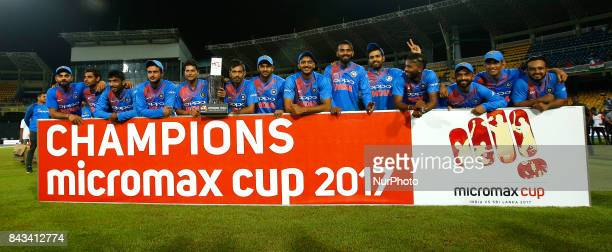 Indian team pose for a group photo after winning the 1st and only T20 cricket match between Sri Lanka and India at R Premadasa International cricket...