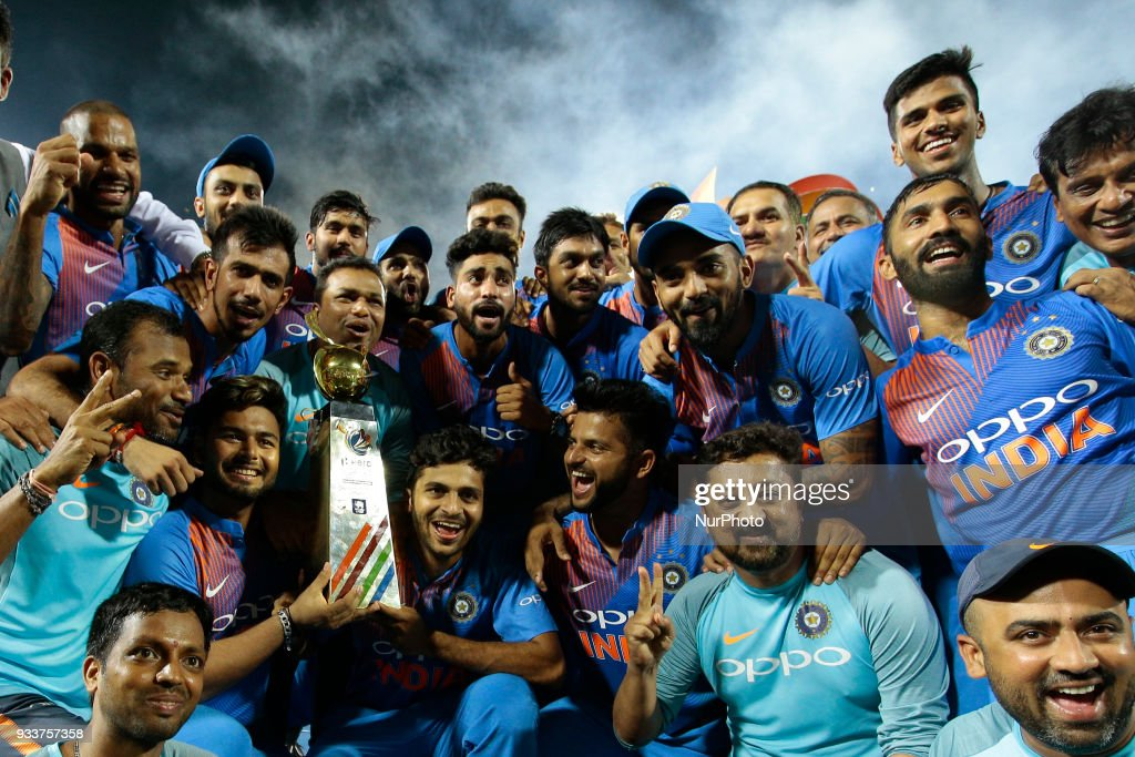 Indian team pose for a photograph after winning the final Twenty-20 cricket match of NIDAHAS Trophy between Bangladesh and India at R Premadasa cricket ground, Colombo, Sri Lanka on Sunday 18 March 2018.