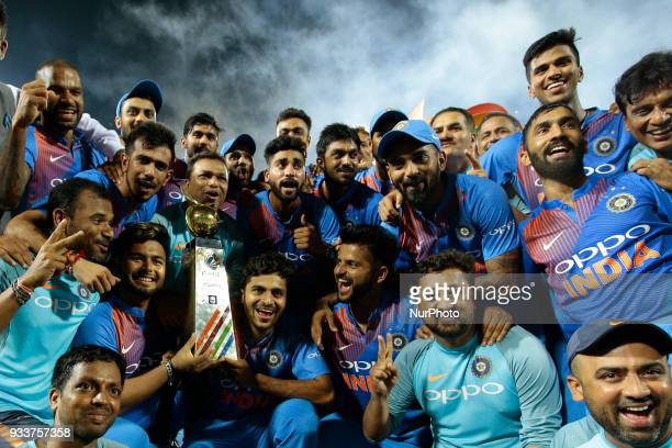 Indian team pose for a photograph after winning the final Twenty20 cricket match of NIDAHAS Trophy between Bangladesh and India at R Premadasa...