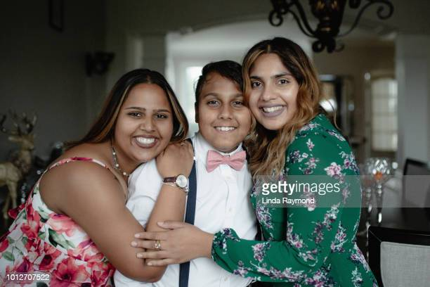 Indian teenage boy with his sisters